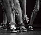 Feet, ankles and arms of a hip-hop performers in cool sneakers — Stock Photo