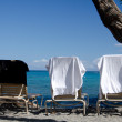 Difference in opinions between beach chairs — Stock Photo #31414107