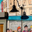 Artful graffiti blended with street lamp near Pike Place — Stock Photo