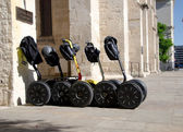 Segways parked near a cathedral in San Antonio — Stock Photo