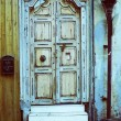 Stock photo of an antique grunge door entrance with lantern and — Stock Photo