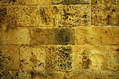 Grunge yellow brick wall — Stock Photo