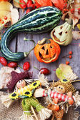 Halloween pumpkins with two scarecrows , still life. — Stock Photo