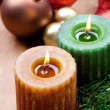 Two christmas candles and bauble, still life. Rustic style.  — Stock Photo