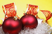 Red christmas baubles with ribbon. — Stock Photo