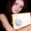 Portrait of beautiful girl with gift — Stock Photo #11793047