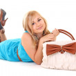 Girl in dress with bag lying on white — Stock Photo #13176783
