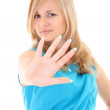 Young woman showing his hand signaling stop — Stock Photo