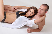 Woman in lingerie and naked man — Stock Photo