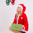 Woman in santa costume with gift — Stock Photo #14031432