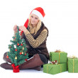 Woman with presents and tree isolated on white — Stock Photo