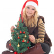 Woman with christmas tree isolated on white — Stock Photo