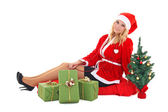 Woman in santa claus costume — Stockfoto