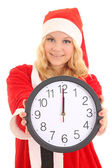 Girl with santa hat holding clock — Stock Photo