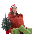 Gnome girl sitting in bag with presents — Stock Photo