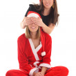 Happy girl closes santas eyes  — Stock Photo