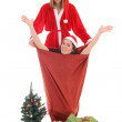 Happy santa and gnome in bag — Stock Photo