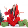 Royalty-Free Stock Photo: Happy girl in santa costume waiting a snow
