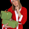 图库照片: Thinking santgirl with gifts
