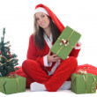 Happy santa with tree holding present — Stock Photo