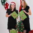 Stock Photo: Two beautiful girls with presents