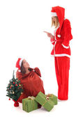 Santa punishes gnome who sit in bag — Stock Photo