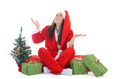 Happy girl in santa costume waiting a snow — Stok fotoğraf