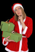 Thinking santa girl with gifts — Stok fotoğraf