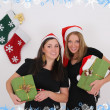 Two beautiful girls with presents - Stock Photo