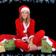 Happy girl in santcostume with presents — Foto de stock #14287621
