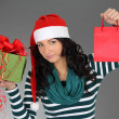 Royalty-Free Stock Photo: Woman in santa hat with gift and bag