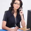 Businesswoman in the office on the phone — Stock Photo