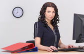 Young businesswoman working in the office — Stock Photo