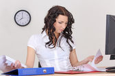 Tired business woman working with documents — Stock Photo