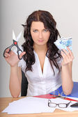 Business woman with euro and scissors — Stock Photo