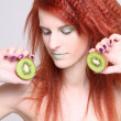 Redhaired girl with kiwi over white — Stock Photo