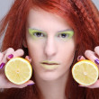 Portrait of redhaired girl with lemon — Stock Photo
