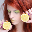 Close up portrait of redhaired girl with lemon — Stock Photo