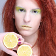 Young attractive woman holding lemon — Stock Photo #18683591