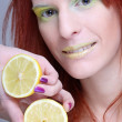 Redhaired girl with lemon. close up — Stock Photo