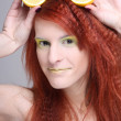 Portrait of redhaired woman with lemon — Stock Photo