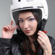 Biker in helmet on head — Stock Photo