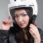 Biker in helmet on head — Stock Photo
