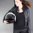 Young pretty woman with helmet in hands — Stock Photo #18687611