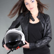 Young woman with helmet in hands — Stock Photo #18687619