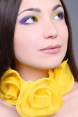 Portrait of dreaming woman with yellow accessory — Stock Photo