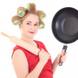 Funny housewife with roller-pin and pan over white — Stock Photo