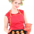 Housewife with hair curlers and muffins — Stockfoto