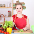 Royalty-Free Stock Photo: Attractive woman cutting salad in the kitchen