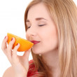 Close up portrait of attractive girl with orange over white — Stock Photo #18985383